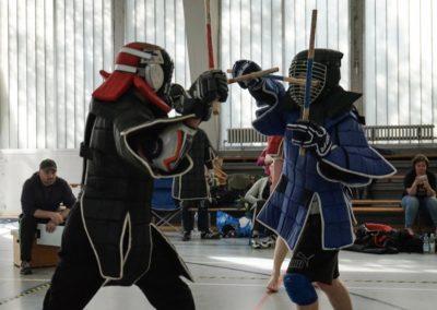 Zwei Wettkämpfer im Doppelstock-Vollkontakt